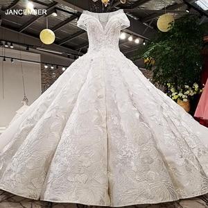 Image 1 - LS59840 see through scoop neck 2018 new design satin cap sleeve big heavy skirt super long train corset back wedding dress
