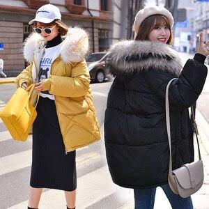 Image 4 - Ciepła kurtka zimowa damska 2020 moda futro z kapturem kołnierz puchowy płaszcz bawełniany kobiety koreański jednokolorowy luźny duży rozmiar damski płaszcz