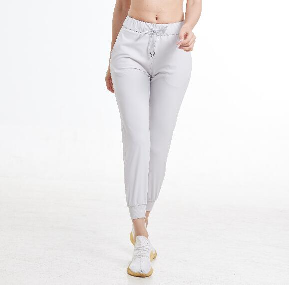 2020 Women Stretch fabrics Loose Fit Sport Active skinny Leggings with two side pockets Ankle-Length Pants 2