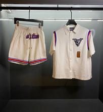 Nowy 2021 moda luksusowy marka projektant koszulki kurtka + spodenki garnitur mężczyźni kobiety list odznaka Casual koszulki w stylu Harajuku Streetwear Tees tanie tanio REGULAR Sukno CN (pochodzenie) Lato COTTON Trójwymiarowy dekoracji tops Z KRÓTKIM RĘKAWEM SHORT Dobrze pasuje do rozmiaru wybierz swój normalny rozmiar