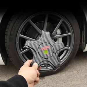 Image 3 - FCXvenle عجلة مركز قبعات ل تسلا نموذج 3 سيارة محور العجلة 5 مخلب واقية يغطي 4 قطعة تعديل السيارات اكسسوارات التصميم