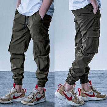 Męskie spodnie Cargo elastyczne wiele kieszeni wojskowe męskie spodnie Outdoor Joggers spodnie spodnie do biegania moda Harajuku męskie spodnie tanie i dobre opinie gym king Na co dzień Wiosna i jesień COTTON CHINA CASUAL Troczek Mieszkanie Pełna długość REGULAR Z KIESZENIAMI 02558