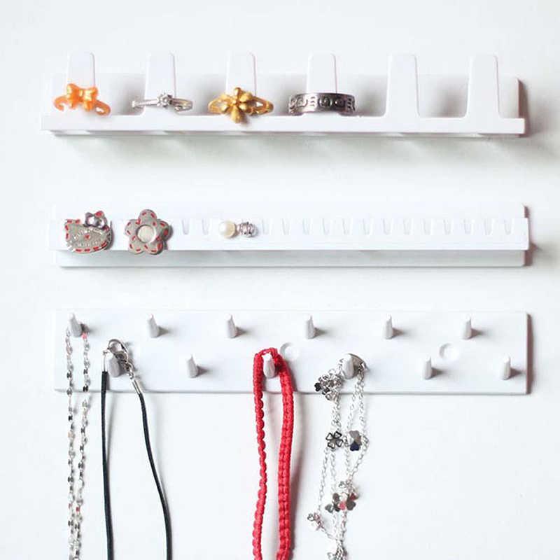 กาวเครื่องประดับ 9-in-1 Storage Rack สร้อยคอสตั๊ดต่างหูผู้ถือแขวนผนังตู้เสื้อผ้าเครื่องประดับ rack