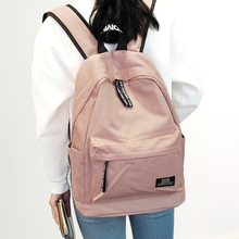 Backpack female Oxford spinning small fresh college wind travel backpack fashion simple solid color school bag middle stu