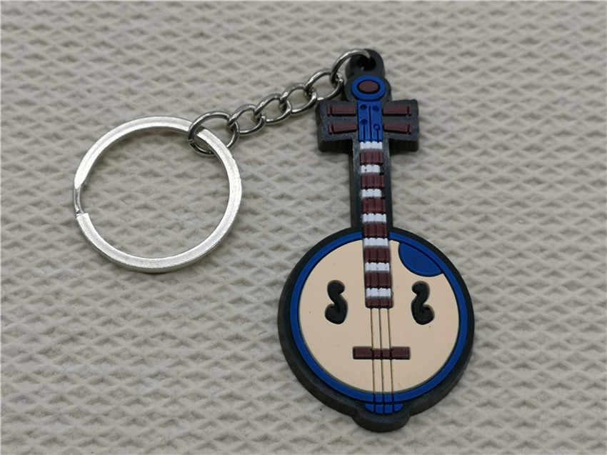 سلسلة مفاتيح صغيرة لطيفة من السيليكون Zhong Ruan سلسلة مفاتيح موسيقية سلسلة مفاتيح عصرية للسيارة قلادة أدوات موسيقية للرجال والنساء هدية