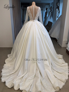 Image 4 - Liyuke 2020 A Line Wedding Dress Ivory Satin Skirt Full Sleeve  Bling Bling Plearls Bridal Dress