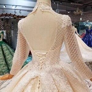 Image 5 - LSS446 ארוך שרוולי חתונת שמלות גבוהה צוואר פתוח keyhole חזרה שמלות כלה תחרה אפליקציות לראות דרך 웨딩 파티 드레스