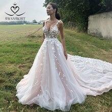 SWANSKIRT Appliques Wedding Dress 3D Flowers Backless A Line 2 In 1 Detachable Train Princess Vestido de novia SA01 Bridal Gown