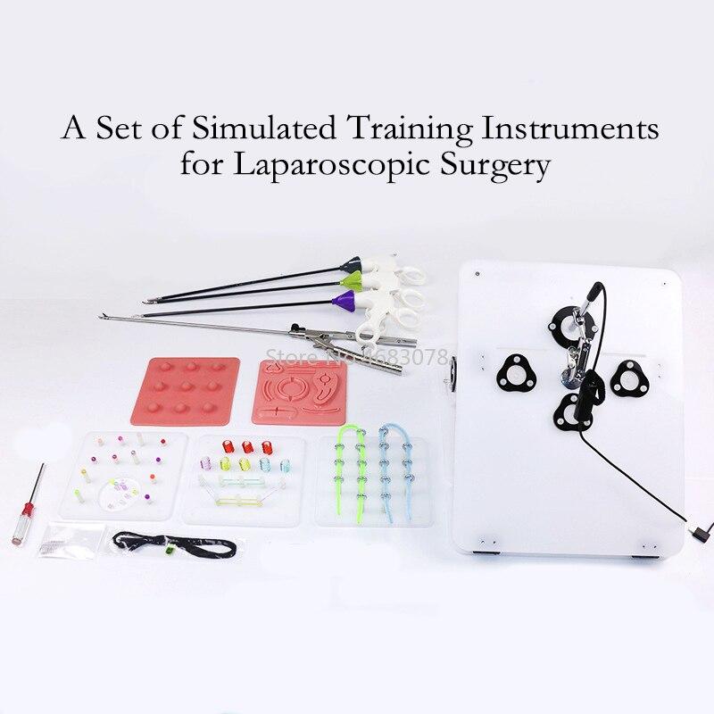 Um conjunto completo de simulador de treinamento de cirurgia laparoscópica, pinças de retenção de agulhas, pinças de separação, clipe de separação, etc