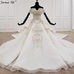 Image 1 - Weiß Schatz Kurzen Ärmeln Luxus Hochzeit Kleider 2020 Perlen Suquins Sexy Dubai Brautkleider HX0070 Nach Maß