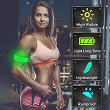 Ilumine acima as braçadeiras do diodo emissor de luz para correr a engrenagem reflexiva que pisca as pulseiras dos esportes do diodo emissor de luz