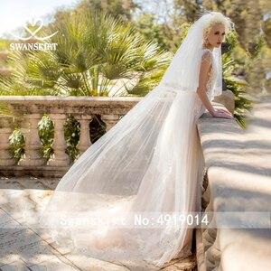 Image 4 - Fee V ausschnitt Perlen Hochzeit Kleid Strand Appliques Illusion Tüll A linie Ärmellose Swanskirt D121 Brautkleid Vestido de novia
