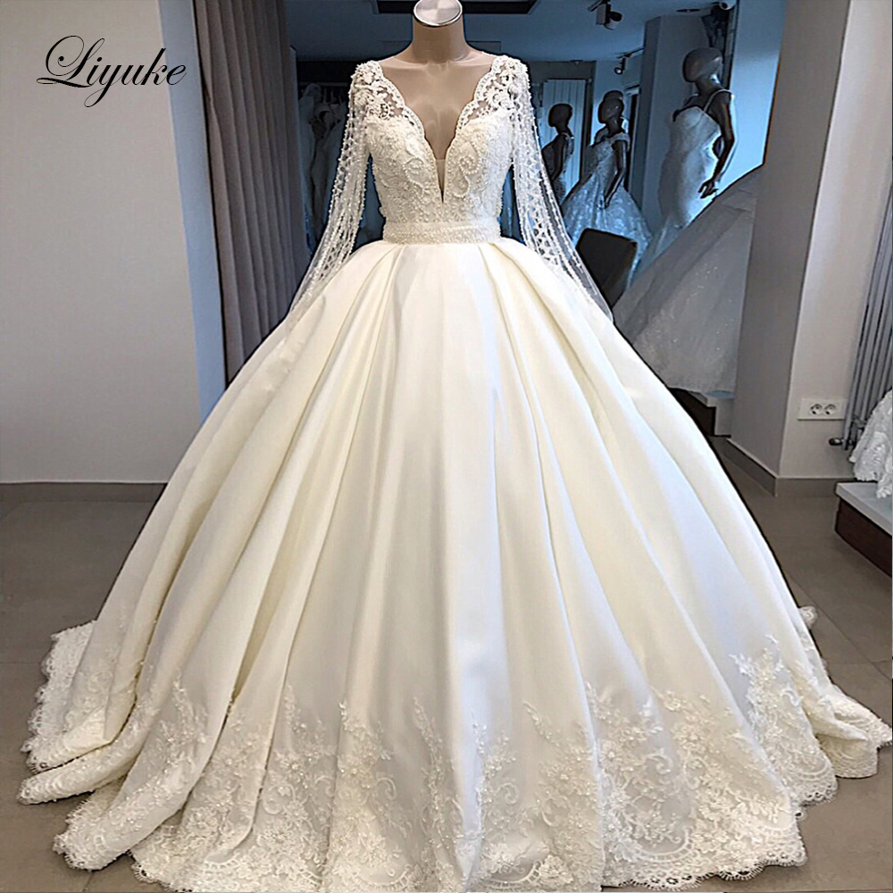 Liyuke 2020 A Line Wedding Dress Ivory Satin Skirt Full Sleev  Bling Bling Plearls Bridal Dress