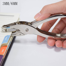 Hand holding round hole punching pliers, single 6MM stationery