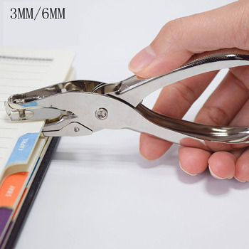 Hand holding round hole punching pliers, single hole 6MM punching stationery punching pliers hole diameter 6mm hole puncher hit 1 8 page hand punch pliers
