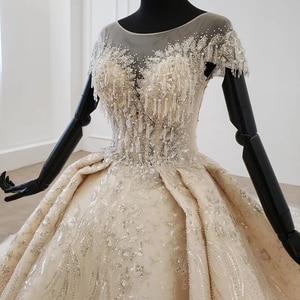 Image 4 - Htl1107 grânulo vestido de noiva vestido de casamento champanhe o pescoço lantejoulas borla cristal espartilho vestido de casamento tampado manga suknie slubne