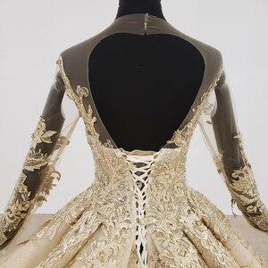 Image 4 - HTL1124 זהב תחרה חתונה שמלות נסיכה לחתוך o צוואר פאייטים ארוך שרוול שמלות כלה שמפניה vestido דה noiva מנגה longa