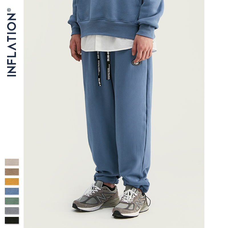 Image 1 - INFLATION DESIGN Super Loose Fit Men Sweatpants In Pure Color Loose Fit Retro Style Mens Sweatpants Street Wear Men Pants 93402W-in Casual Pants from Men's Clothing