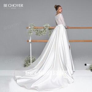 Image 2 - Bechoyer Luxe Lange Mouwen Satin Wedding Dress 2020 Sexy Kralen A lijn Trein Illusion Princess Bride Gown Vestido De Noiva EL05