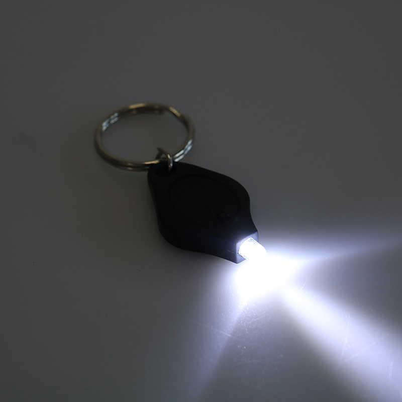 LED Mini Gantungan Kunci Lampu Outdoor Camping Darurat Kunci Cincin Lampu Squeeze Light Micro Senter Built-In CR2016 Baterai