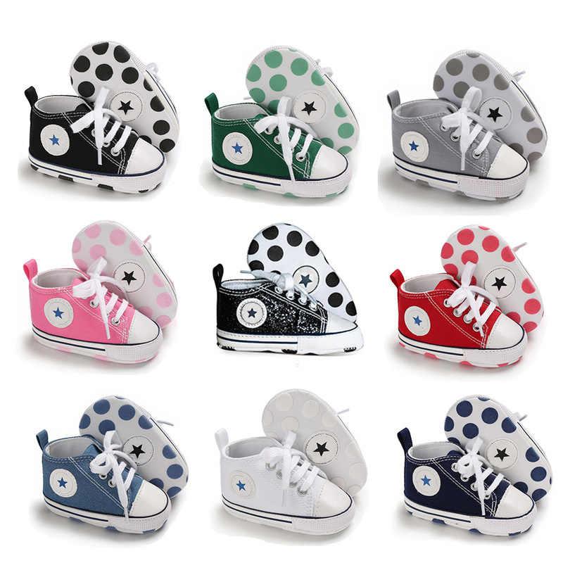 Yenidoğan ilk yürüyüşe beşik ayakkabı beyaz yumuşak kaymaz taban Unisex Toddler rahat tuval bebek bebek erkek kız ayakkabı