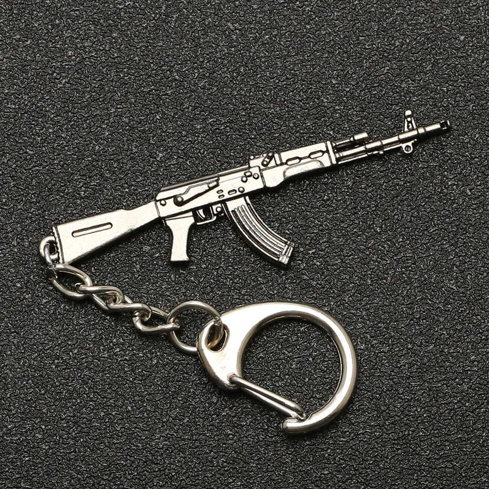 PUBG Sleutelhanger M416 AKM LITTEKEN AWM M24 Kar98k VSS Rugzak Armor Helm Pan Flare Pistool Sleutelring Ring Leger sieraden Groothandel