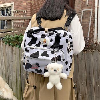 Nylonowe małe krowy Spotted szkolne torby dla nastolatków dziewczyny śliczne kobiety szkolne plecaki na laptopa torby podróżne na ramię kobiece torby na książki tanie i dobre opinie SHEFLYTO CN (pochodzenie) Tłoczenie WOMEN Miękka 20-35 litr Wnętrze slot kieszeń Kieszeń na telefon komórkowy Wnętrza przedziału