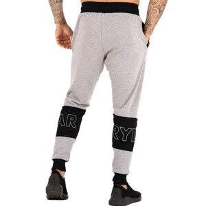 Image 5 - Pantalon de sport pour homme, pantalon de Fitness pour jogging, en coton extensible, vêtement Slim pour entraînement, automne, décontracté