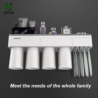UNITOR Plastic Toothbrush Holder Wall Mounted Automatic Toothpaste Dispenser Cosmetic Storage Rack Bathroom Accessories Set