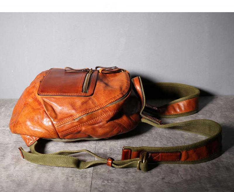 curtido couro em forma de concha de couro macio mochila