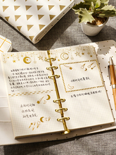 Gold-stamped loose-leaf Handbook This artistic notebook plans this diary