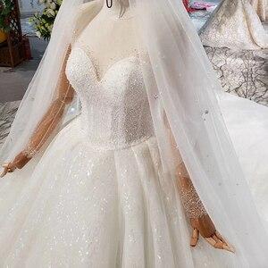 Image 4 - HTL823 فساتين زفاف لامعة مع الحجاب الزفاف الوهم o الرقبة فساتين زفاف طويلة مع الأكمام vestido de noiva 2020