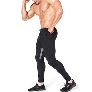 Nowe markowe spodnie do joggingu męskie spodnie sportowe spodnie do biegania męskie spodnie do biegania Fitness spodnie do biegania dopasowane obcisłe spodnie kulturystyka spodnie tanie i dobre opinie Ołówek spodnie CN (pochodzenie) Mieszkanie Poliester Octan Patchwork REGULAR 68 - 72 Pełnej długości 1315 Na co dzień