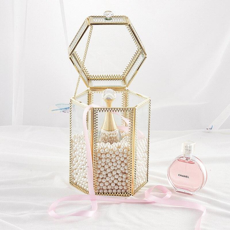Nouveau habillage européen maquillage hexagone boîte de rangement flip transparent anti-poussière porte-stylo luxe métal verre boîte de rangement 14*21cm