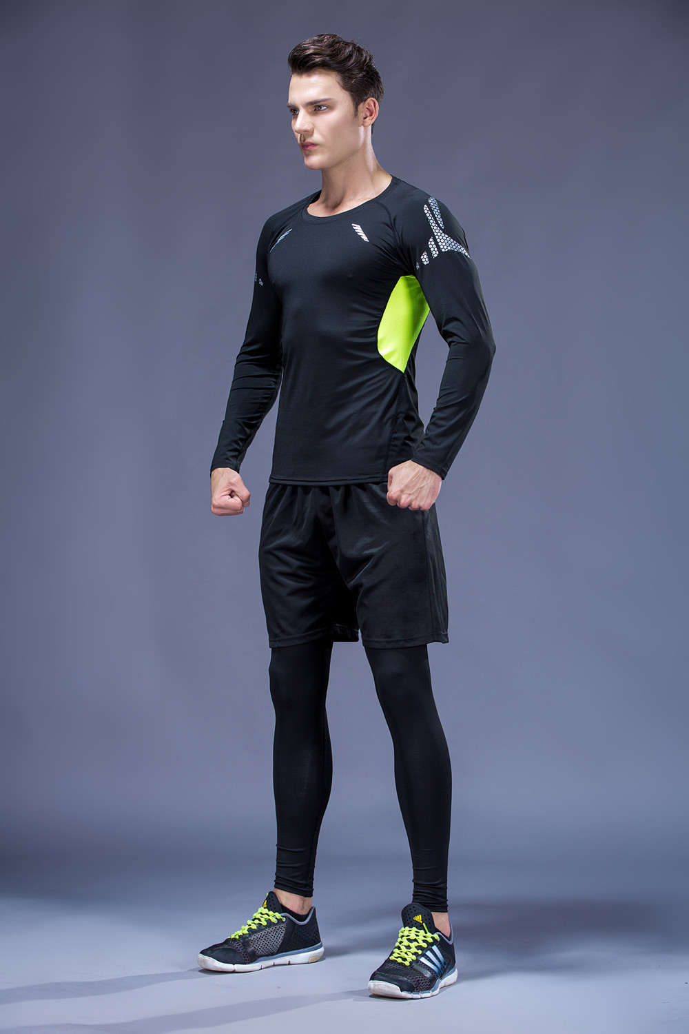 Foto from the right on men 5 pcs compressions clothes for gym. Men's 5 pcs compression tracksuit sports