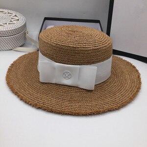 Image 2 - ファッションボンネット気質ラフィアバイザービーチ休暇わら帽子 M 標準女性の優雅な弓フラットキャップ太陽の帽子