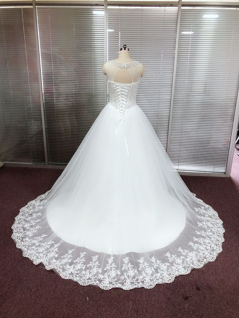 Exquisite Tulle Jewel Neckline Ball Gown Wedding Dresses With Pearls Beading Sleeveless Lace Appliques Bridal Gowns 2021 3