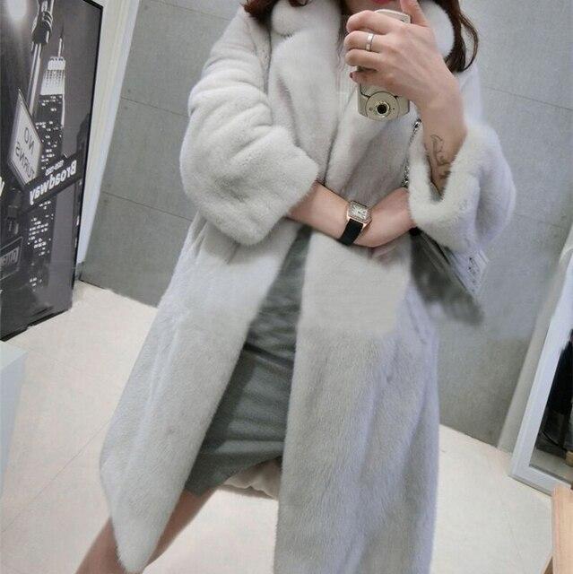 Фото женская длинная свободная куртка из искусственного меха норки