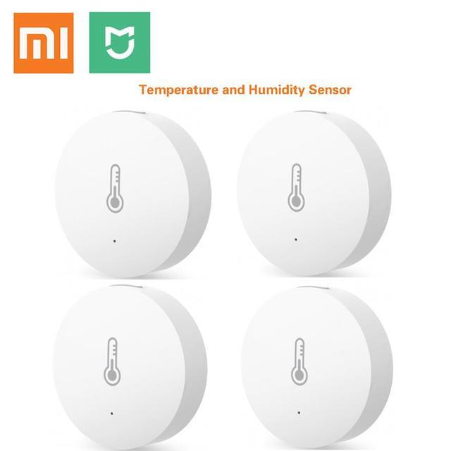 Xiaomi mi aqaraスマート温度と湿度センサーを置くベビーホームオフィス作業でアンドロイドios miホームアプリ