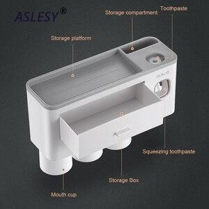 Image 4 - Suporte de escova de dentes magnética adsorção invertido dispensador creme dental montagem na parede rack armazenamento maquiagem para acessórios do banheiro conjunto