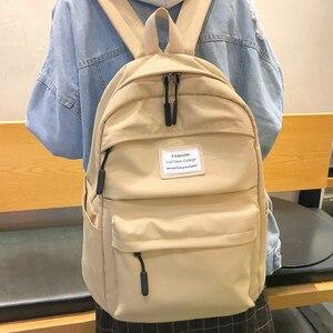 Image 4 - JOYPESSIE moda su geçirmez sırt çantası siyah okul çantası kadın erkek basit genç kız için naylon büyük seyahat Mochilas sırt çantası