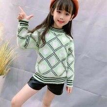 Теплый вязаный пуловер из меха норки с геометрическим рисунком