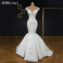 Dubai Luxury Mermaid Wedding Dress 2019 Exquisite Sleeveless Floor Length See Through Back Arabic Wedding Gowns Custom Made