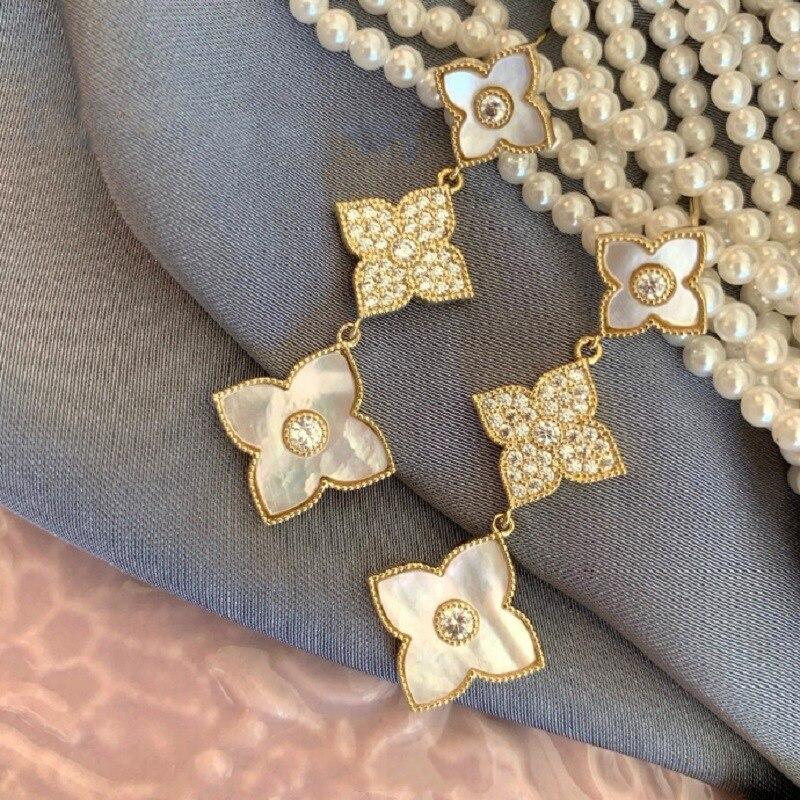 NPKDS New Korean Fashion Four-leaf Clover Zircon Earrings Long Tassel Temperament Ladies Earrings Jewelry