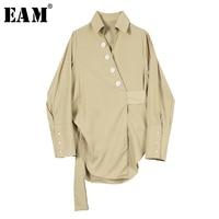 [EAM] 2019 New Spring Summer Lapel Long Sleeve Black Oblique Button Waist Banadage Irregular Shirt Women Blouse Fashion JR698