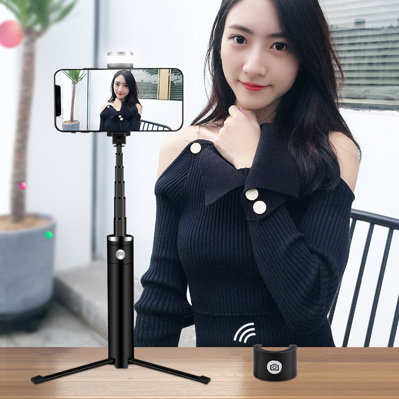 Image 4 - Portable Mobile Phone Holder Tripod Camera With A Wireless Bluetooth Remote Self Timer Artifact Rod-in Selfie Sticks from Consumer Electronics