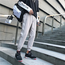 2018 Autumn and winter New Pattern Harbor wind Beam foot trousers Motion pants loose Hip-hop Korean Edition casual Mens wear