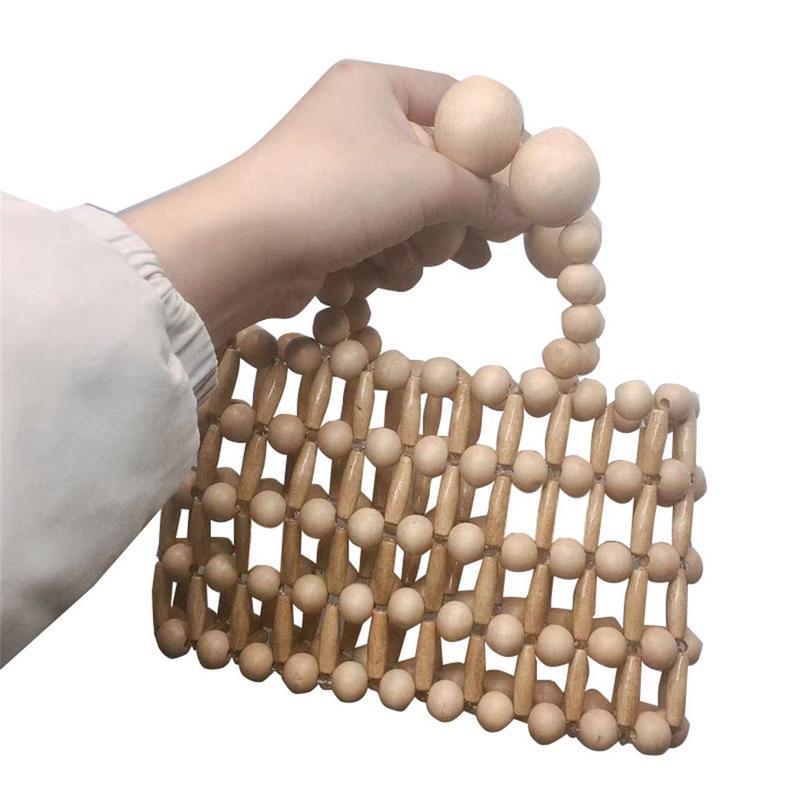 Women Ins Style Hand Woven Hand Bag Tote Beach Natural Wood Beads Bamboo Handbag For Summer Female Ladies Fashion Handbags BagsWomen Ins Style Hand Woven Hand Bag Tote Beach Natural Wood Beads Bamboo Handbag For Summer Female Ladies Fashion Handbags Bags