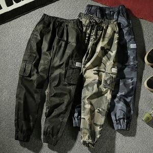 Image 1 - 7XL Men 2019 Spring Autumn Casual Cotton Pockets Cargo Pants Trousers Men Army Military Tactical Fleece Warm Trouser Pant Men