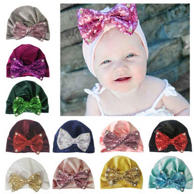 แฟชั่นทารกแรกเกิดเด็กวัยหัดเดินเด็กทารกเด็กชายหญิง Turban กำมะหยี่หมวก Beanie หมวกฤดูหนาวหมวก Sequined โบว์ผ้าพันแผลนุ่มหมวกหมวก